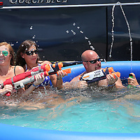 Race fans play in their pool in the infield prior to the 57th Annual NASCAR Coke Zero 400 stock car race at Daytona International Speedway on Sunday, July 5, 2015 in Daytona Beach, Florida.  (AP Photo/Alex Menendez)