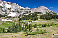 Snowy Range Scenic Byway (HWY 130) passes below Sugarloaf Mountain and Medicine Bow Peak of the Snowy Range.  Wyoming.