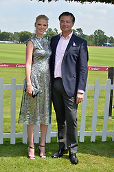 Lara Stone and Laurent Feniou at Cartier Queen's Cup Polo, Guard's Polo Club, Berkshire, England. 18 June 2017.<br /> Photo by Dominic O'Neill/SilverHub 0203 174 1069 sales@silverhubmedia.com