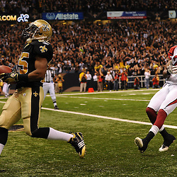 16 January 2010: New Orleans Saints running back Reggie Bush (25) runs away from Arizona Cardinals cornerback Greg Toler (28) for a tochdown during a 45-14 win by the New Orleans Saints over the Arizona Cardinals in a 2010 NFC Divisional Playoff game at the Louisiana Superdome in New Orleans, Louisiana.