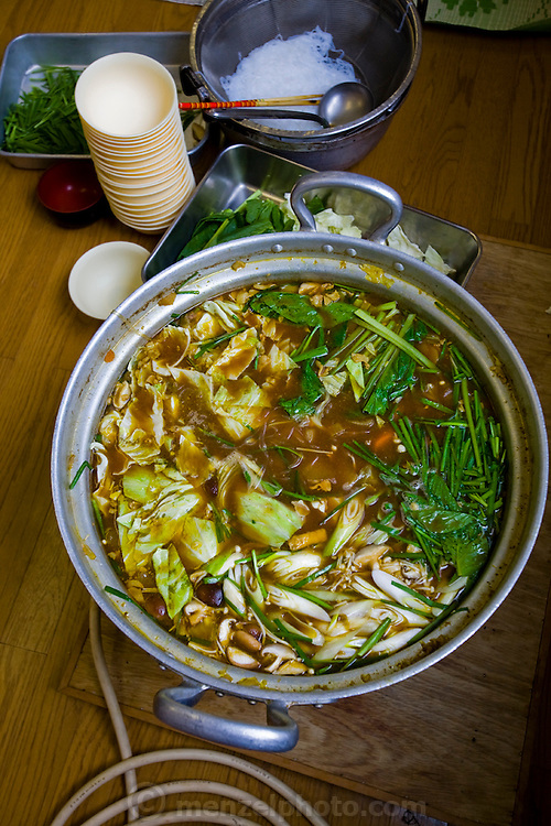 A meal of chanko nabe prepared by sumo wrestlers of the Professional Sumo Team (Musahigawa Beya) while practicing for a wrestling tournament in Nagoya, Japan. Sumos cook and eat chanko nabe, a stew pot of vegetable and meat or fish, at nearly every meal. It  is eaten with copious amounts of rice and numerous side dishes.