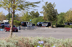 July 23, 2017 - San Antonio, Texas, U.S. - Police vehicles are seen at a Walmart parking area after it was cordoned off by local police in San Antonio, Texas, the United States, on July 23, 2017. Eight people were found dead in a trailer carrying illegal immigrants at the Walmart parking area in southern Texas City of San Antonio early Sunday morning, authorities said. (Credit Image: © Yan Bo/Xinhua via ZUMA Wire)