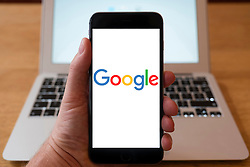 Using iPhone smartphone to display logo of Google