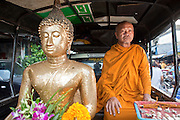 Sept. 23, 2009 -- BANGKOK, THAILAND: A Buddhist monk sits in the back of a pickup truck with a statue of Buddha in the Khlong Toey slum in Bangkok. Khlong Toey slum in Bangkok, Thailand, is the largest slum area in Bangkok. Photo by Jack Kurtz