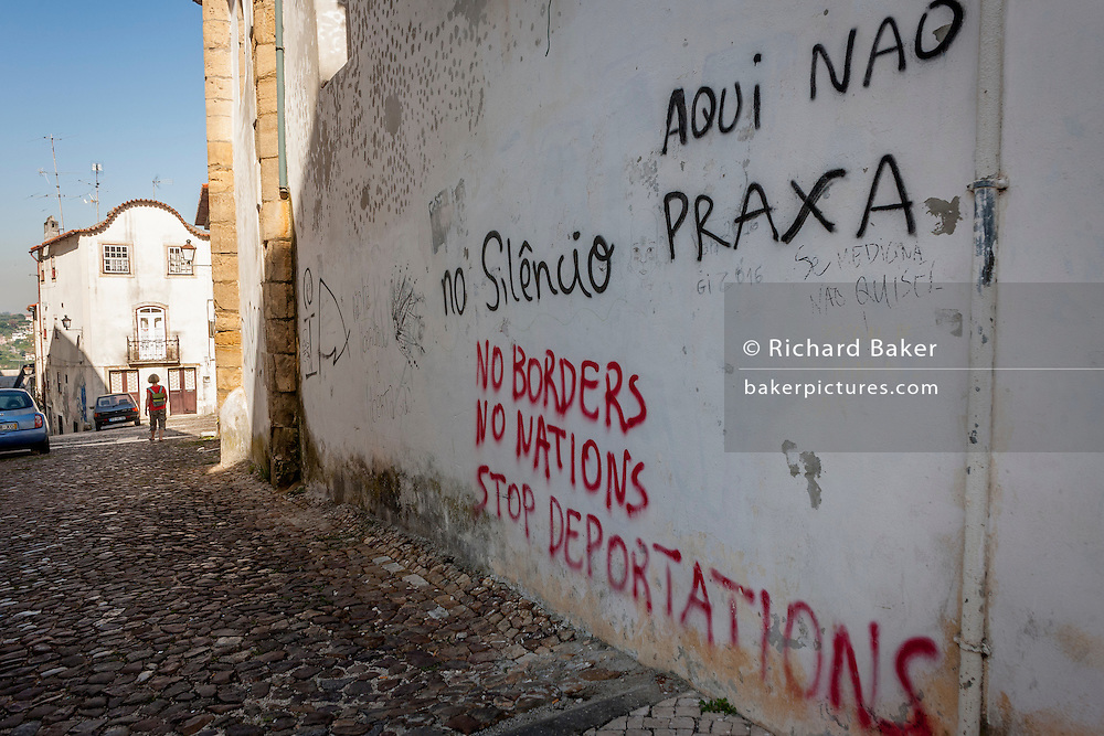 Political messages and graffiti saying 'No Borders, No Nations and to Stop Departations' adorn walls on a street near Coimbra University, on 17th July, at Coimbra, Portugal. (Photo by Richard Baker / In Pictures via Getty Images)