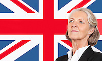 Close-up of senior businesswoman over British flag