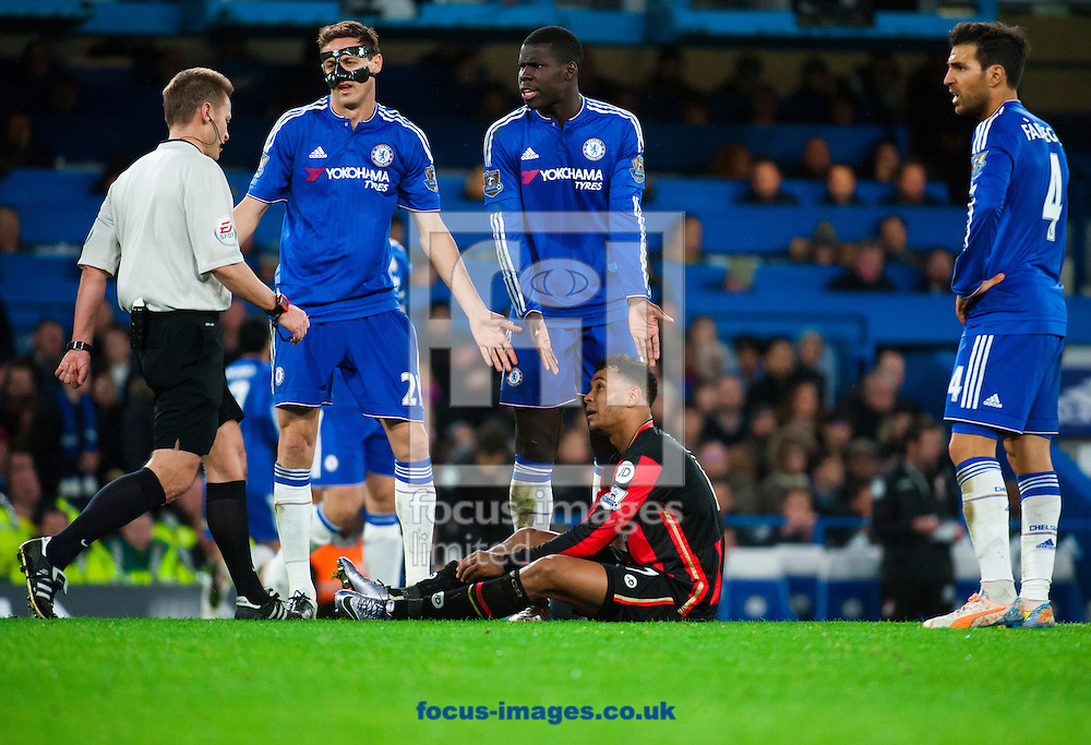 Nemanja Matic of Chelsea Kurt Zouma of Chelsea and Cesc Fabregas of Chelsea appeal to the referee over time wasting after Tokelo Rantie of AFC Bournemouth goes down with cramp during the Barclays Premier League match at Stamford Bridge, London<br /> Picture by Jack Megaw/Focus Images Ltd +44 7481 764811<br /> 05/12/2015