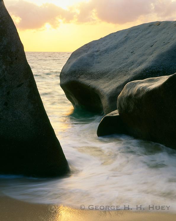 6202-1002 ~ Copyright: George H. H. Huey ~ Granite boulders form The Baths at sunset.  Virgin Gorda Island.  [Tortola in distance].  British Virgin Islands.  Caribbean.