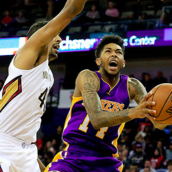 Nov 12, 2016; New Orleans, LA, USA;  Los Angeles Lakers forward Brandon Ingram (14) shoots over New Orleans Pelicans center Alexis Ajinca (42) during the first half of a game at the Smoothie King Center. Mandatory Credit: Derick E. Hingle-USA TODAY Sports