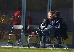NEWPORT, WALES - Sunday, February 8, 2015: Wales' head of international affairs Mark Evans watches as Wales U18 Academy take on South Wales during a friendly match at Dragon Park. (Pic by David Rawcliffe/Propaganda)