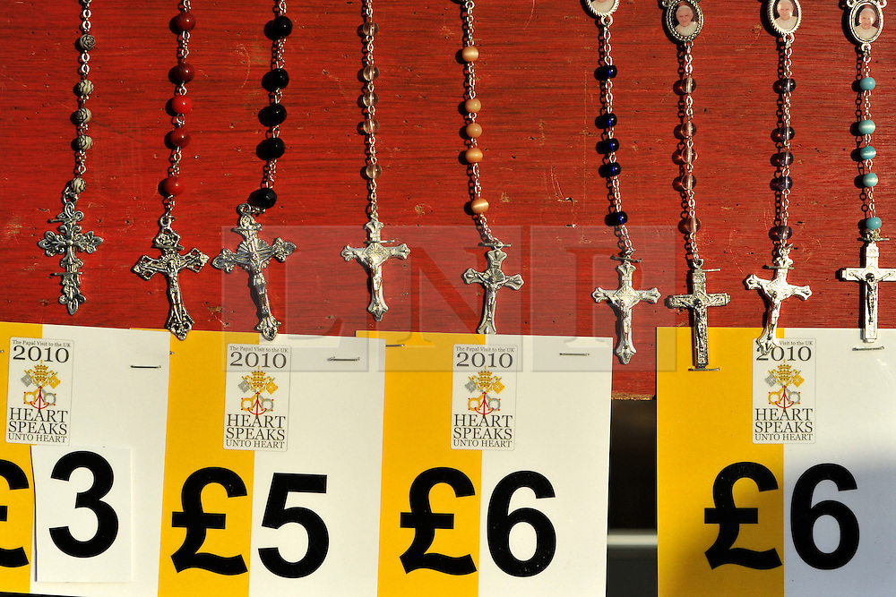 CENTRAL LONDON. Official mechandise on sale at the Hyde Park Vigil.  Crowds of Londoners, visitors and pilgrims visit London for the visit of Pope Benedict XVI on 17/18th September 2010. It is estimated that 80,000 people will flock to see the Pontiff during his visit to the capital. 18th September 2010.STEPHEN SIMPSON.