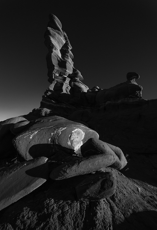 This hoodoo is located in a remote, roadless area in Arizona. Taken at sunrise, the black and white version makes it very timeless and gives it even more of a feeling of mystery.