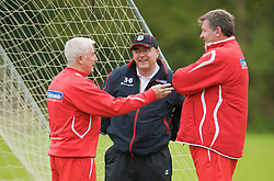 CARDIFF, WALES - Monday, October 13, 2008: Wales' manager John Toshack and assistant coach Roy Evans chat with FAW press officer Ceri Stennett during training at the Vale of Glamorgan Hotel ahead of the 2010 FIFA World Cup South Africa Qualifying Group 4 match against Germany. (Photo by David Rawcliffe/Propaganda)