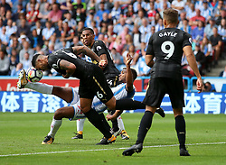 Huddersfield Town's Steve Mounie challenges Newcastle United's Jamaal Lascelles - Mandatory by-line: Matt McNulty/JMP - 20/08/2017 - FOOTBALL - John Smith's Stadium - Huddesfield, England - Huddersfield Town v Newcastle United - Premier League