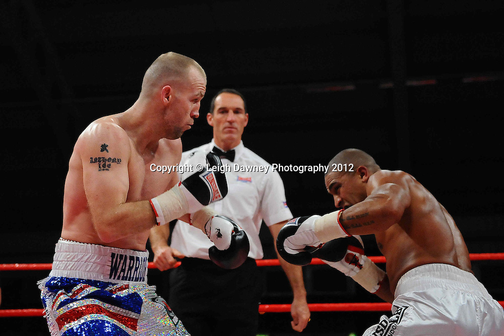 Tony Dodson (Union Jack shorts) defeats John Anthony defeats Kirk Goodings in a 6x3 Super Middleweight contest on the 30th November 2012 at Aintree Equestrian Centre, Aintree, Liverpool. Frank Maloney Promotions. Pictures by Leigh Dawney. ©leighdawneyphotography 2012.