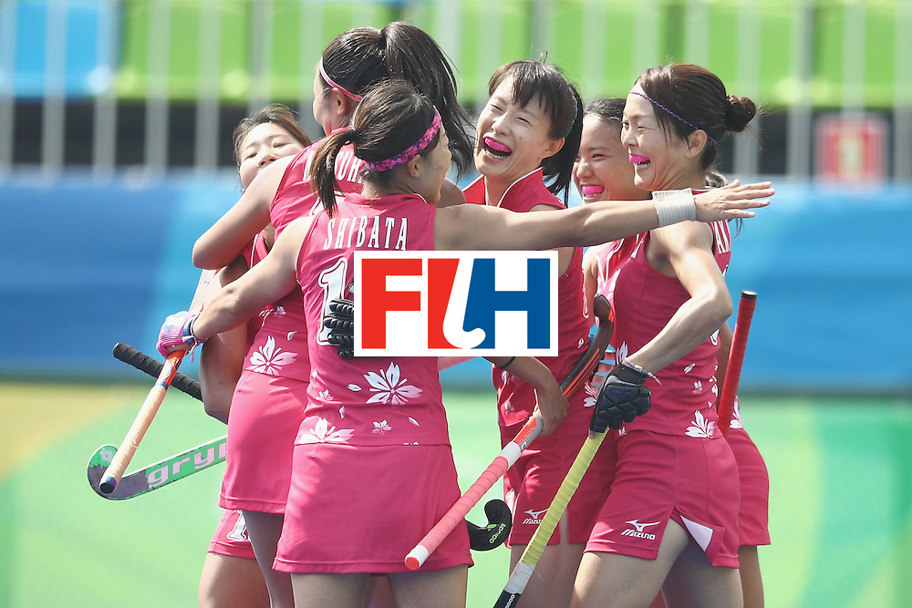 RIO DE JANEIRO, BRAZIL - AUGUST 07:  The Japan players celebrate with Mie Nakashima of Japan after she scored a goal during the women's pool B match between Japan and India on Day 2 of the Rio 2016 Olympic Games at the Olympic Hockey Centre on August 7, 2016 in Rio de Janeiro, Brazil.  (Photo by Mark Kolbe/Getty Images)