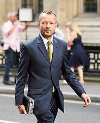 © Licensed to London News Pictures. 18/07/2018. London, UK. JONATHAN MUNRO, Head of Newsgathering at the BBC arrives at the Rolls Building of the High Court in London where judges will deliver their decision on a claim by Sir Cliff Richard for damages against the BBC for loss of earnings. The 77-year-old singer is suing the corporation after his home in Sunningdale, Berkshire was raided following allegations of sexual assault made to Metropolitan Police. Photo credit: Ben Cawthra/LNP