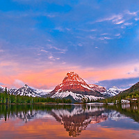 calm spring sunrise, brilliant skys, and calm reflection, two medicine lake, sinopah, glacier national park