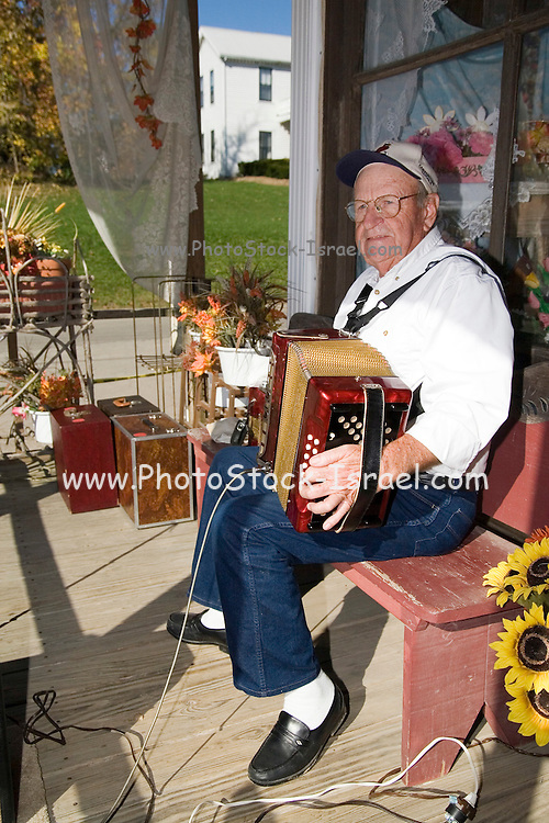 Missouri MO USA, An old accordion player playing Polka in Kimmswick, MO. October 2006