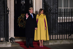 London, UK. 3 December, 2019. Donald Trump, President of the United States, arrives with his wife Melania Trump for a reception for NATO leaders at 10 Downing Street on the eve of the military alliance's 70th anniversary summit at a luxury hotel near Watford.