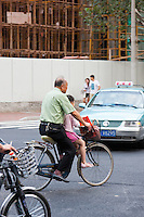 people on bikes in Shanghai China