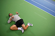 Michal Przysiezny of Poland warm up before training session four days before the BNP Paribas Davis Cup 2014 between Poland and Croatia at Torwar Hall in Warsaw on March 31, 2014.<br /> <br /> Poland, Warsaw, March 31, 2014<br /> <br /> Picture also available in RAW (NEF) or TIFF format on special request.<br /> <br /> For editorial use only. Any commercial or promotional use requires permission.<br /> <br /> Photo by © Adam Nurkiewicz / Mediasport