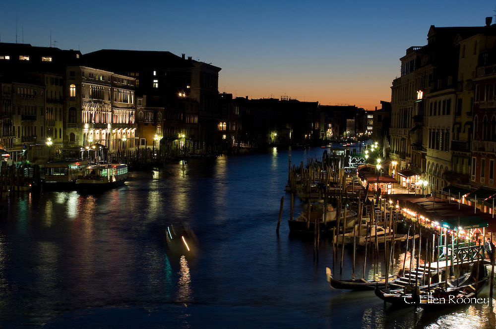 A view from the Rialto Bridge of the Grand Canal at dusk;  Venice, Italy