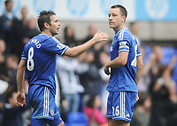 Football - 2013 / 2014 Premier League - Tottenham Hotspur vs. Chelsea<br /> <br /> Goalscorer John Terry - Chelsea glances over at the Tottenham fans as they give him a hard time at White Hart Lane. Frank Lampard (left)<br /> <br /> COLORSPORT/ANDREW COWIE