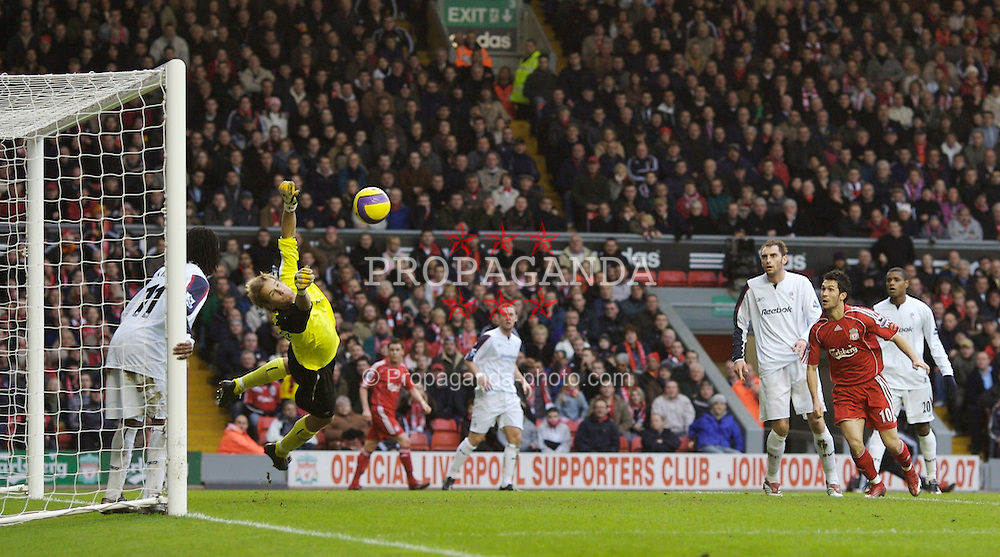 Liverpool, England - Monday, January 1, 2007: Liverpool's Sami Hyypia is denied by a great save from Bolton Wanderers' goalkeeper Jussi Jaaskelainen during the Premiership match at Anfield. (Pic by David Rawcliffe/Propaganda)