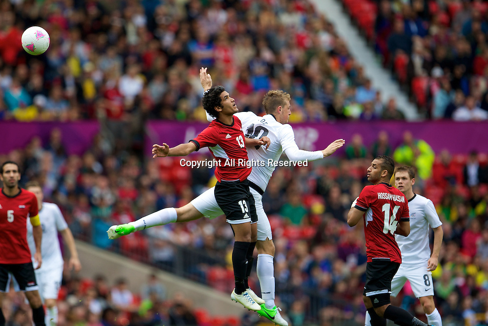 29.07.2012 Manchester, England. Egypt midfielder Saleh Gomaa New Zealand forward Chris Wood in action during the first round group C mens match between Egypt and New Zealand.
