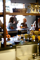 Patrons at the bar at The Block Restaurant in Webster Groves in St. Louis, MO.