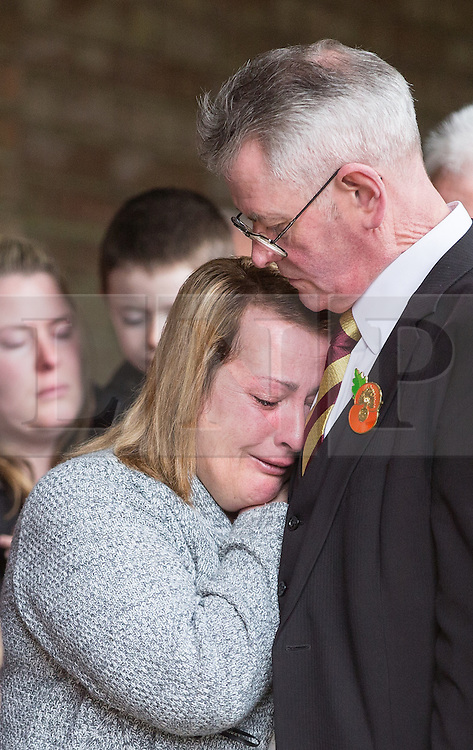 © Licensed to London News Pictures . 29/03/2015 . Manchester , UK . Lee's Mother Lyn Rigby and step-Father Ian . A bronze drum , in memory of Fusilier Lee Rigby , is unveiled in Middleton Memorial Gardens , North Manchester at a memorial service in his honour . Rigby was murdered in a terrorist attack in Woolwich in May 2013 . Photo credit : Joel Goodman/LNP