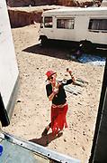 Woman in red trilby, Middle East Tek, Wadi Rum, Jordan, 2008