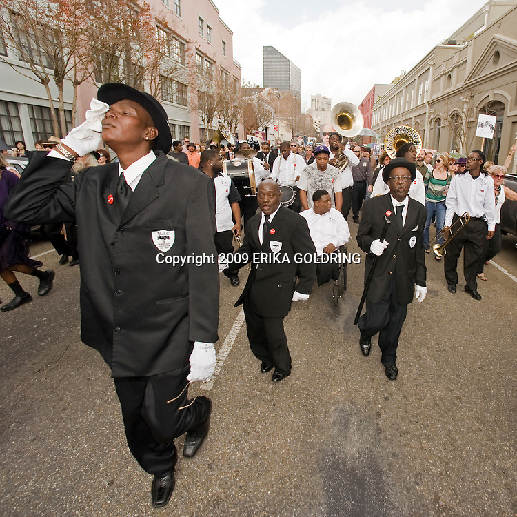 Senior Division of Young Men Olympia Social Aid & Pleasure Club & Hot 8 Brass Band perform at Snooks Eaglin's 2nd line parade in New Orleans, LA, February 27, 2009.