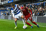 Marvin Johnson (21) of Middlesbrough battles for possession with Dominic Ball (12) of Queens Park Rangers during the EFL Sky Bet Championship match between Queens Park Rangers and Middlesbrough at the Kiyan Prince Foundation Stadium, London, England on 9 November 2019.