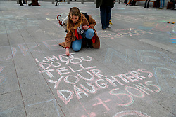 """© Licensed to London News Pictures. 25/01/2015. LONDON, UK. """"No More Page 3"""" campaigners protesting against The Sun's decision to bring the 'Page 3' back after a week, outside News UK HQ in central London on Sunday, 25 January 2015. Photo credit : Tolga Akmen/LNP"""