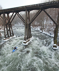 A kayaker makes his way down the Winnipesaukee River in Franklin during the annual New Year's Day kayak run on Saturday, January 1, 2011.  (Alan MacRae/for the Monitor)