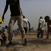 People gesture away from a landing United Nations World Food Programme (WFP) helicopter in Rubkuai village, Unity State, northern South Sudan.