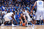 LEXINGTON, KY - DECEMBER 5: Aaron Harrison #2 and Alex Poythress #22 of the Kentucky Wildcats defend against Javan Felix #3 of the Texas Longhorns during the game at Rupp Arena on December 5, 2014 in Lexington, Kentucky. The Wildcats defeated the Longhorns 63-51. (Photo by Joe Robbins)