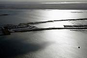 Nederland, Zuid-Holland, Tiengemeten, 04-03-2008; restanten van het eilandje in het Haringvliet, gezien naar Overvlakkee; oorspronkelijk eigendom - binnen de dijken - van AMEV (Fortis Investments),en Natuurmonumenten (buitendijkse slikken); het eiland werd gebruikt voor de akkerbouw maar is inmiddels 'teruggegeven aan de natuur' (dijken deels doorgestoken) , de laatste boer is in 2006 vertrokken; huidig gebruik onder andere zorgboerderij en kan er gekampeerd worden; nieuwe natuur, onderdeel van de Ecologische Hoofdstructuur; natuurontwikkelingsgebied, natuurontwikkeling natuurontwikkeling; tiengemeenten. .luchtfoto (toeslag); aerial photo (additional fee required); .foto Siebe Swart / photo Siebe Swart