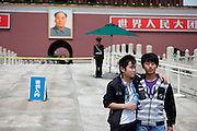 "Visitors and tourists getting photographed in front of the famous Mao portrait at the main gate of ""The Forbidden City"" which was the Chinese imperial palace from the Ming Dynasty to the end of the Qing Dynasty. It is located in the middle of Beijing, China. Beijing is the capital of the People's Republic of China and one of the most populous cities in the world with a population of 19,612,368 as of 2010."