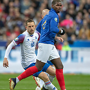 PARIS, FRANCE - March 25:  Paul Pogba #6 of France defended by Gylfi Por Sigurdsson #10 of Iceland during the France V Iceland, 2020 European Championship Qualifying, Group Stage at  Stade de France on March 25th 2019 in Paris, France (Photo by Tim Clayton/Corbis via Getty Images)