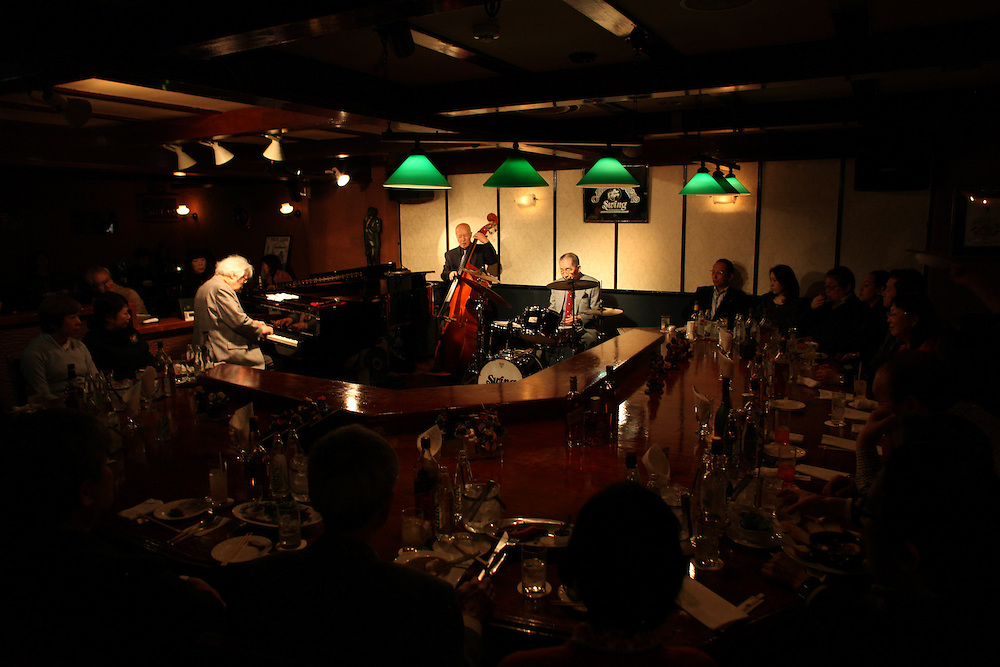 Ginza SWING Jazz club <br /> a very Japanese experience small club in central tokyo offering a unique supper club atmosphere  reminiscent of the  economic bubble period of Japanese after work places mostly regulars using the  &quot;bottle keep&quot; method  where the  club would sell a bottle and keep it for your exclusive use when ever you visited to assure you your  brand would always be available to you. the  combined age of these master of Jazz musicians is over 200 years old with the youngest member in his 70's  great experience of real Japanese jazz at its finest.