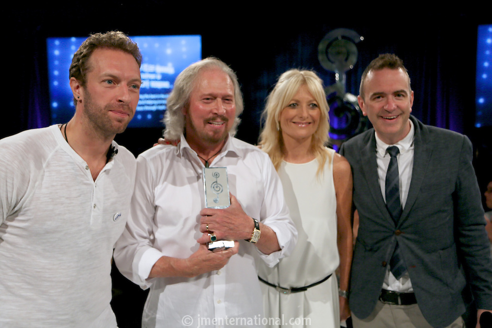 (L-R) Chris Martin (Coldplay), Barry Gibb, Gabby Roslin, Scott Anderson - Sony Mobile. The Silver Clef Lunch 2013 in aid of Nordoff Robbins held at the London Hilton, Park Lane, London.<br /> Friday, June 28, 2013 (Photo/John Marshall JME)