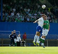 Photo: Andrew Unwin.<br />Northern Ireland v Azerbaijan. FIFA World Cup Qualifying match. 03/09/2005.<br />Northern Ireland's James Quinn (R) outjumps Azerbaijan's Rafael Amirbekov (L).