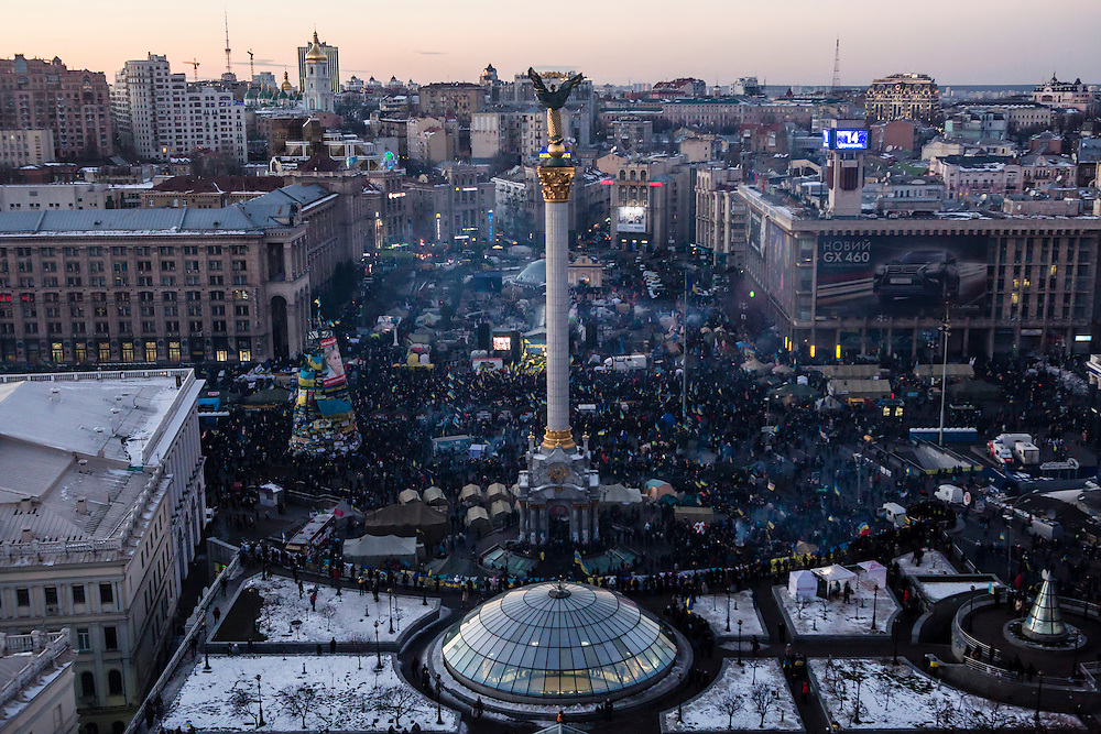 KIEV, UKRAINE - DECEMBER 14: Independence Square, filled with anti-government protesters, at sunset on December 14, 2013 in Kiev, Ukraine. Thousands of people have been protesting against the government since a decision by Ukrainian president Viktor Yanukovych to suspend a trade and partnership agreement with the European Union in favor of incentives from Russia. (Photo by Brendan Hoffman/Getty Images) *** Local Caption ***