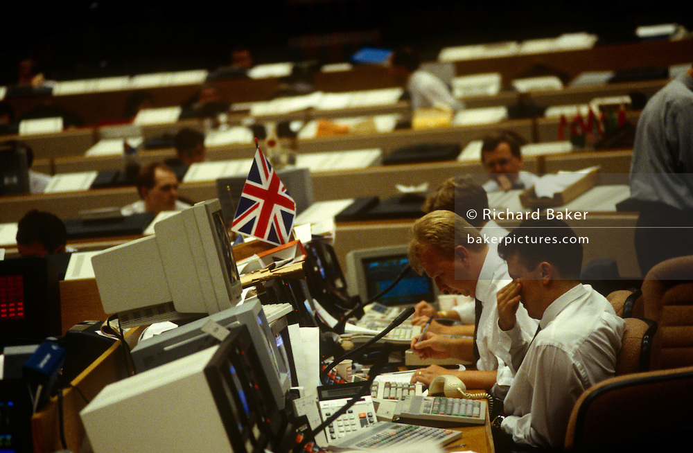 An interior of office desks and 90s computers in the currency trading floor of National Westminster Bank PLC in London
