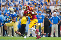 17 October 2012: Wide receiver (2) Robert Woods of the USC Trojans catches a pass and runs against the UCLA Bruins during the first half of UCLA's 38-28 victory over USC at the Rose Bowl in Pasadena, CA.