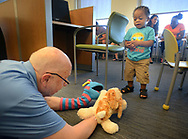 "Volunteer, and Penn Memory Center patient Leslie Wolff entertains Hasan Sturgis, 1 year old, with his puppets Tuesday, September 05, 2017 at CHOP Care Network in Philadelphia, Pennsylvania. The Penn Memory Center, which serves people with dementia mild cognitive disorder, has a new volunteer partnership with CHOP. Its patients and ""normal controls"" volunteer with CHOP patients. (WILLIAM THOMAS CAIN / For The Philadelphia Inquirer)"