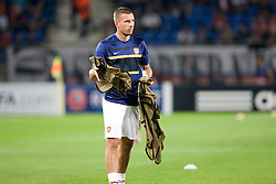 Lukas Podolskiis assigned the job of collecting the bibs warms up before the Champions League group match between Montpellier and Arsenal at the Stade la Mosson, Montpellier, France, 18th September 2012. Eoin Mundow/Cleva Media